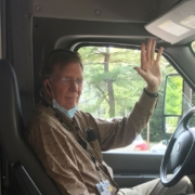 Interior of Bus with Driver Waving Hello